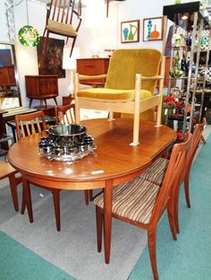 G-Plan oval dining table with leaf. Set of six G-Plan chairs, 2 arm and 4 sides.