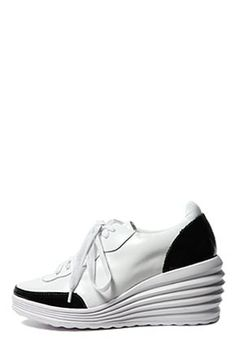 Today's Hot Pick : CORRERE-BLACK/WHITE http://fashionstylep.com/SFSELFAA0034858/stylenandaen/out Tired of the flats? Then opt for a towering lace-up wedge sneakers. This pair features futuristic wedge heels, white body with black linings, and lace-up top. Look fast-paced with everything from skinny jeans to skirts.