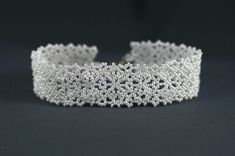 This lacy bracelet is woven with all white seed beads. At about with a silver snap clasp, this would make a lovely accessory for any outfit. All White, Seed Beads, Weaving, Diamond, Bracelets, Pretty, Silver, How To Make, Accessories