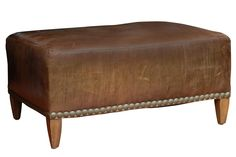 Vintage French leather ottoman from the 1930's.  Metal detailing on the bottom gives it a casual, yet sophisticated feel.