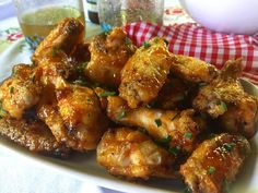 J Firecracker Wings! Just in time for the Fourth a simple speedy & crazy tasty wing recipe with a secret ingredient that makes these oven-fried wings extra crispy! Lemon Pepper Wings, Wings In The Oven, My Cookbook, Man Food, Fries In The Oven, Wing Recipes, Appetizer Dips, Sweet And Spicy, Chicken Wings