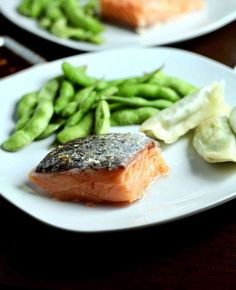 For perfectly cooked salmon every time, look no further than this sous vide recipe. For an Asian flare, the salmon is served with a garlic ginger sauce. Sous Vide Salmon Recipes, Cooking Salmon, Fish Recipes, Seafood Recipes, Healthy Recipes, Shrimp Pasta Dishes, Ginger Salmon, Ginger Sauce, Sous Vide Cooking