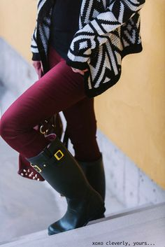My black and white sweater with burgundy pants and black boots.