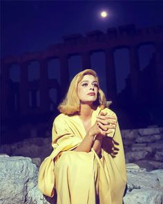 Melina Mercouri under the Acropolis illuminated by the moonlight
