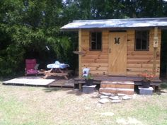Playhouse from pallets. I used a few boards that I had around the house and I bought the log for the front. Table and chairs are from pallets, they are setting on the deck also made from pallets. I have about four hundred dollars in it. A lot cheaper than buying one.
