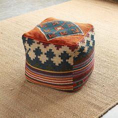 "CASA KILIM POUF -- Put up your feet or use as seating. This colorful pouf is covered with a hand-woven rug inspired by antique Turkish kilims. Lightweight and easy to move. Shell: Wool/cotton. Filling: Polystyrene balls. Imported. Catalog exclusive. 16"" cube."