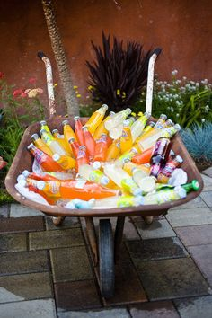 A wheelbarrow (filled with an assortment of refreshments) greets thirsty guests.