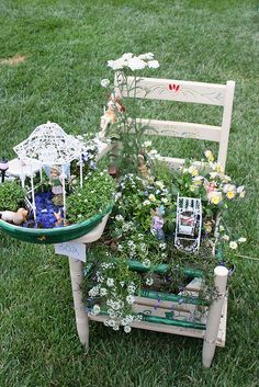 Fairy garden built on a charming wooden chair. What a great idea!