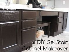 DIY Gel Stain Cabinet Makeover - The Creative Cubby....so doing this if I fall for a house with a perfect floor plan but ugly, dated cabinets. I so like dark cabinets. Will be adding hardware too.