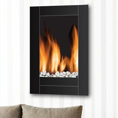 This elegant wide screen wall mount electric fireplace comes with dual heat settings and a built-in timer. Description from homeskitchenstore.com. I searched for this on bing.com/images