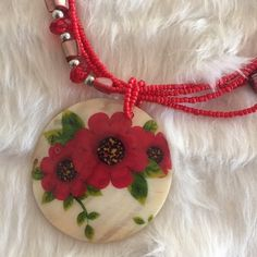 NLRed flower set Brand new. Handmade shell necklace and matching earrings. Gorgeous red flower design. Bella B Jewelry
