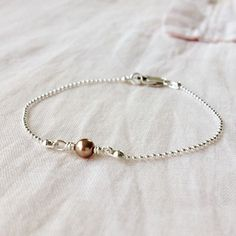 So I'm playing around with some new ideas that I *may* put up on my website...I'm trialing this one today! Always inspired by classic styles and simplicity! #jewellery #jewelry #bracelet #ukjewellery #ukcraft #britishcraft #classic #simplicity #bandofun #thatsdarling #mybeautifulmess #tnchustler #etsy #etsy #lukh #etsyseller #swarovski #pearl #silver #inspired #style #instafashion