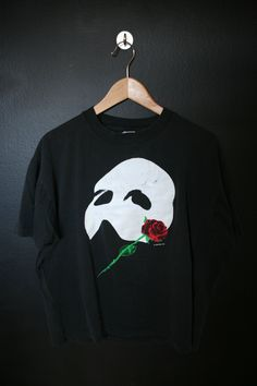 Phantom of the Opera vintage Tshirt with front print. Size XL. Measurements Pit to Pit: 23 Back of Collar to Bottom: 26 We do our best to describe all items. All shirts are sold in As-Is condition. Please keep in mind that this is a used vintage shirt so there will be age appropriate wear. Feel f
