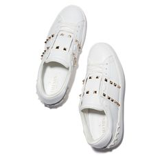 $795 Valentino's signature rockstuds—some in silver, some embossed into the rubber sole—make these simple, smooth white leather sneakers extra-cool. Upper: Leather w