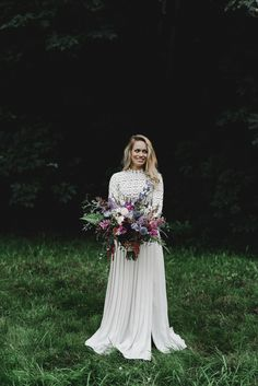 Long sleeved wedding dress and cool-toned bouquet   Image by Noelle Johnson