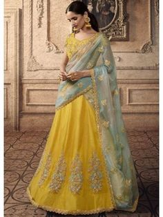 Design and style and pattern will be on the peak of your attractiveness as soon as you dresses this yellow color net lehenga choli. The desirable embroidered and resham work a intensive element of this dress. Lehenga Anarkali, Lehenga Indien, Lehenga Choli Online, Bridal Lehenga Choli, Indian Lehenga, Silk Lehenga, Anarkali Suits, Choli Designs, Lehenga Designs