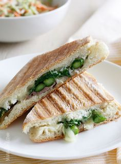 Asparagus Prosciutto Panini with Garlic Mayonnaise - Melted Swiss cheese, asparagus, proscuitto, arugula and garlic mayonnaise pressed in a ciabatta. Did that just make your stomach growl? If you can make a grilled cheese, you can make a panini, that's how easy it is. 9points+ #weightwatchers #sandwich #panini