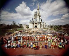 October 1, 1971: Walt Disney World opens in Orlando, Florida  Photo: Group portrait of entire Walt Disney World staff standing in front of Cinderella Castle prior to grand opening of amusement park. Yale Joel/Time Life Pictures/Getty