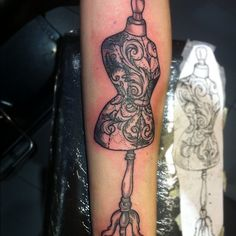 lovely dress form tattoo with scroll work details