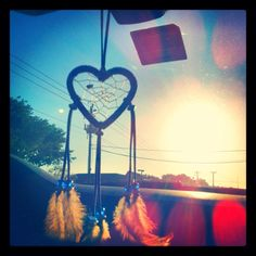I want a tattoo of a heart dream catcher. So pretty! Since everyone has the original dream catcher tatted.