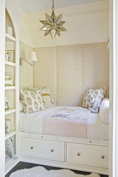 Adorable girl's bedroom with bed built into nook that has padded walls