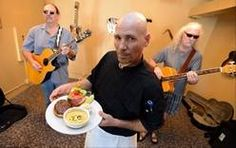 Chef Jeff Schmehl traded life on the road as a tour caterer for the kitchen at Mac's on Slade, a new eatery and music venue in downtown Palatine. His Beer Burger pleases patrons and musicians, like Joel Tarpinian of Island Lake and Mac Rietz of Tower Lakes.