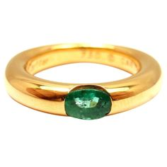 CARTIER Elipse Emerald Yellow Gold Band Ring   From a unique collection of vintage band rings at http://www.1stdibs.com/rings/band-rings/