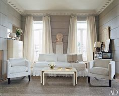 sitting room of a Manhattan triplex renovated by Sills features a wall treatment that references the stonework of the nearby Frick Collection.