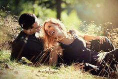 young couple smiling at each other during a romantic date in the forest