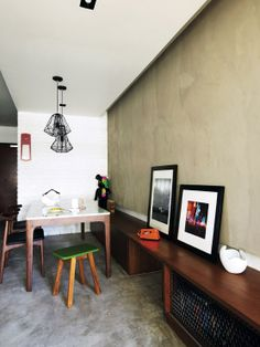 [hot fave] Love this: Seats, wall, photo frames - Wire frame lamps from Motto cast interesting shadows over the dining area. Ceramic bowl on bench from Atomi.