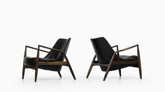Ib Kofod-Larsen seal chairs in teak and leather at Studio Schalling