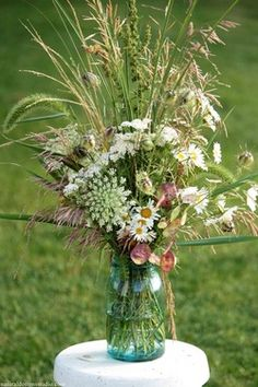 wild flowers in mason jars for center pieces