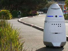 Here Are Microsoft's New Robot Security Guards | Robots are increasingly replacing humans in a variety of mundane tasks, like bolting a car together or making lollipops, but now they are moving into the security business. [Future Robots: http://futuristicnews.com/category/future-robots/ Robotics Books: http://futuristicshop.com/category/robotics-books/ Robots for the Home: http://futuristicshop.com/category/robots/]