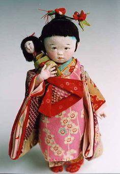 """Mieko Minazumi "" A cute kimono-clad toddler doll holding an anesama ningyou with a cloth body and wooden head."