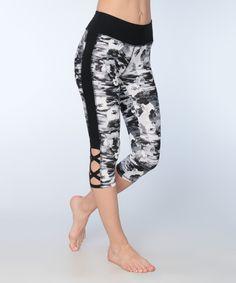 Take a look at this Black Floral Lattice-Bottom Capri Leggings today!