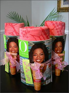 End of the year teacher gift: a rolled-up beach towel, wrapped in a fun magazine, and tied with sunblock and ribbon.