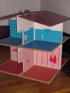 very cool Vintage Dollhouse    modular doll house....everything slips apart and the roof folds so it can be stored flat...screen printed on wood fiber board....no brand markings...assuming it is late 60s early 70s,