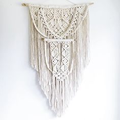 """multi-layered macrame wall hanging made with 100% cotton rope; hangs from driftwood. 22 1/2""""W (driftwood) 36""""L (at longest point) *ready to ship in 2-3 business"""