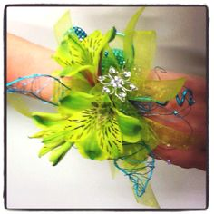 It's that time of year again, time for Prom! This lovely wrist corsage was designed by Monroe Cranford of Flowers and Home in Bryant, AR. Call today to order yours! 1(501)847-5511