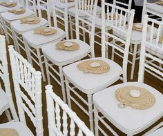 Thoughtful touches: each guest's seat is set with a woven fan to help guests combat the tropical heat.