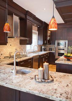 Cozy kitchen design with granite countertops and dark brown cabinets #granite #tiles #kitchen #home #interior #naturalstone #decor