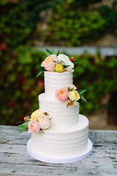 White Wedding Cake Decorated with Fresh Flowers | Brides.com