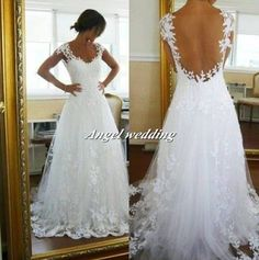 Wedding Dress Vintage Lace. Beautiful Lace Wedding Dress. Would go so well with a simple country wedding.
