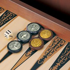 Backgammon with 30 numismatic draughts, depicting 15 Byzantine Emperors, as they were depicted on the coins of the Byzantine Empire. Dimensions: Draughts: 3,5cm Coins: 2,4cm Board: 43,5cm x 51,5cm x 6,5cm Wooden board and draughts, made of alabaster, solid silver 925° and vermeil.