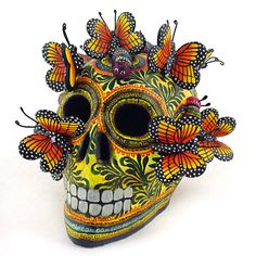 Skull decorated with monarch butterflies