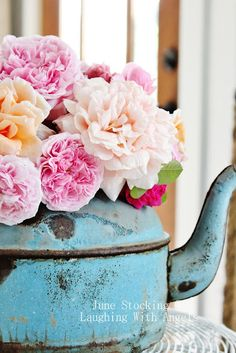 This is gorgeous!  Vintage rusty turquoise teapot filled with flowers for a rustic wedding centerpiece... ♥ Find all sorts of vintage pieces and repurpose into arrangements
