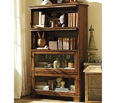 Store and display books and decor with bookshelves and cabinet furniture from Pottery Barn. Our bookshelves feature beautiful designs and solid construction. Furniture Upholstery, Bar Furniture, Cabinet Furniture, Office Furniture, Office Decor, Pottery Barn Bookcase, Antique Bookcase, Vintage Bookshelf, Bookcase With Drawers
