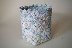 Paper woven into various size baskets - comics, colorfu magazine pictures, flat pieces of used wrapping paper, etc.