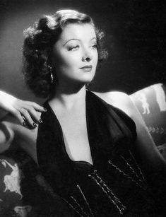 Myrna Loy in a white evening dress, 1930s. Description from pinterest.com. I searched for this on bing.com/images