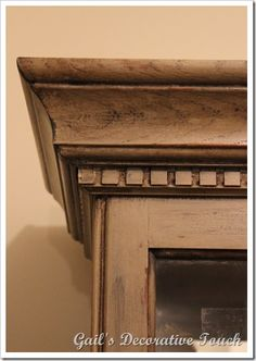 """Annie Sloan finish - """"First I painted the entire piece with country gray and then lightly brushed graphite here and there.  After it dried, I sprayed water and wiped it down to show signs of  wear.  Next, I applied dark wax"""""""